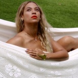 It's no secret--Beyonce loves the beach, water--nature. Not sure what photographer to credit for this shot that makes her seem nude in a hammock--again just speaks to the understated side of this artist.